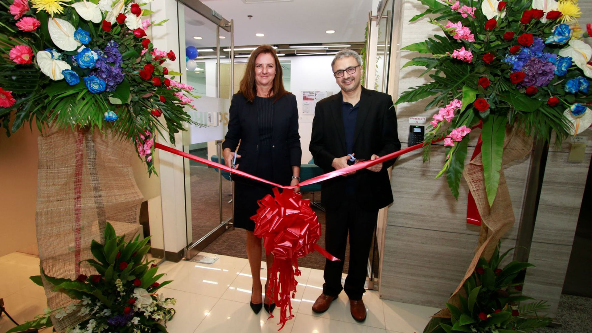 Caroline Clarke and Ashwin Chari during the ribbon cutting ceremony for the new Philips Philippines opening